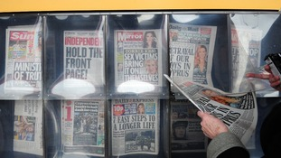 File photo of a general view of newspapers on sale.