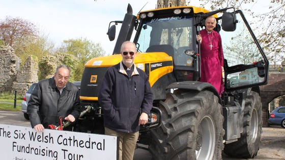 Tractor and men of the church
