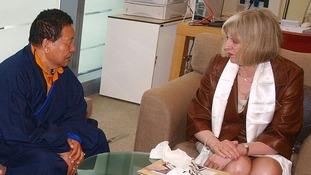 Dr Choje Akong Tulku Rinpoche talking to Home Secretary Theresa May.