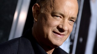 Tom Hanks arrives at the premiere of Captain Phillips in Los Angeles.