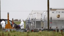 A forensic officer removes a package from a UPS container at East Midlands Airport in 2010.