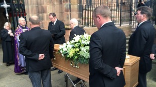 The coffin arrives at St Peter's Collegiate Church in Wolverhampton