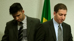 Glenn Greenwald (r) and his partner David Miranda as he testifies in front of the Brazilian Federal Senate.
