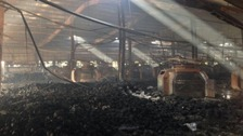 Smouldering balls of yard litter floor of the garment factory