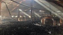 Smouldering balls of yard litter floor of the garment factory