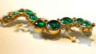 Salamander brooch set in gold with emeralds and diamonds
