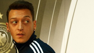 Germany's Mesut Ozil leaves the press conference in Cologne, Germany