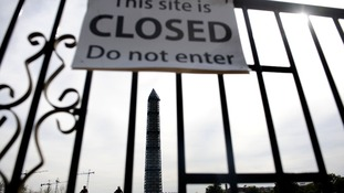 The Washington Memorial in Washington, DC, with a 'This site is closed, do not enter' sign.
