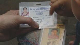 Bojol holds ID cards belonging to the parents he lost in the building collapse