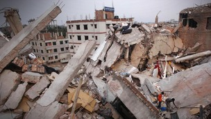 Men attempt to rescue the garment workers from the rubble of the collapsed Rana Plaza building