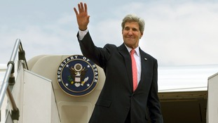John Kerry waves as he leaves Malaysia this afternoon.
