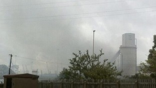 Smoke rises above Port of Tyne.