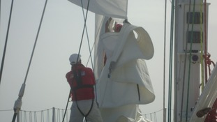 Battling to change a sail