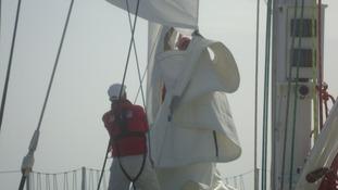 Battling to change a sail