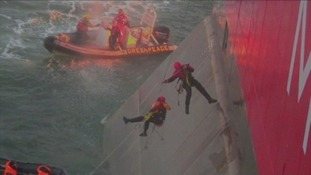 Activists rappel from a Russian oil rig in the Arctic