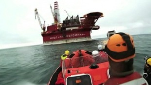 A Greenpeace vessel approaches the oil rig