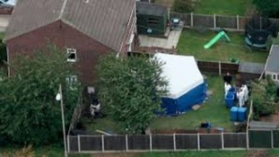 Forensic examinations in the garden of a Mansfield house where two remains were found