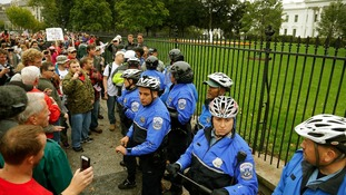 Law enforcement officers clash with protesters from the 'Million Vet March on the Memorials'.