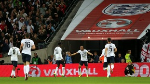 England's Andros Townsend (centre) celebrates scoring his side's third goal of the game against Montenegro at Wembley on Friday.