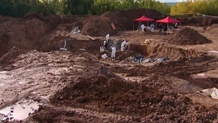 Forensic scientists have so far unearthed 150 bodies -  an average of 10 bodies a day.
