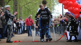 Claire Lomas, 32, crossing the finish line earlier today
