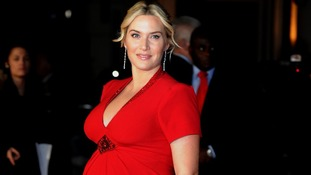 Kate Winslet glowed in a red embellished dress.