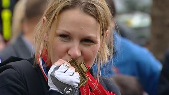 Claire with a donated medal at the finish