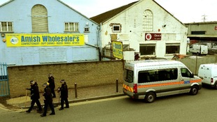 Police Officers and van outside the Glen Cash & Carry warehouse in Barking