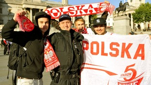 Polish football fans pose with a Police Officer (second left) in Trafalgar Square