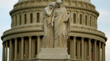 The statue of Grief and History stands in front of the Capitol Dome in Washington.