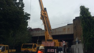 Crane moves into position to help clear the track