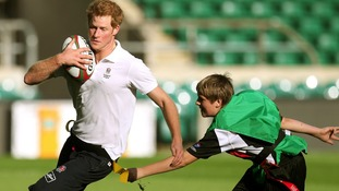 Prince Harry avoids a tackle at Twickenham