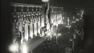 Selfridges in Oxford Street, illuminated at night, 1935
