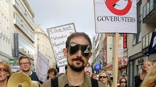 A teacher dressed as a 'Govebuster' marches through Brighton.