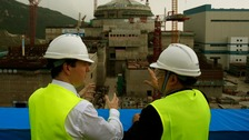 Chancellor George Osborne (L) visits a nuclear power plant under construction in Taishan, Guangdong province