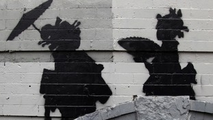 Banksy's newest work in Williamsburg depicting two women in kimonos, before the work was defaced.