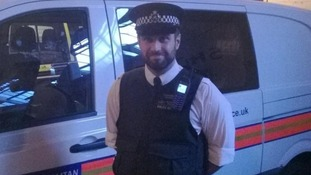 PC Robert Morgan poses for the camera at the end of his shift.