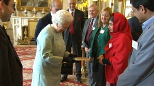 Malala presented the Queen with her book.