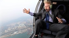 Johnson's iconic hairstyle was exposed to the elements during a helicopter ride.