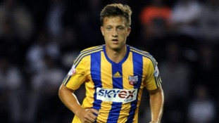 Brentford striker Luke Norris has signed for Northampton Town on a month's loan.