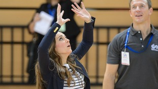Kate playing volleyball while visiting the SportsAid charity in east London