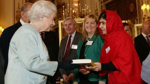 Malala presented the Queen with a copy of her book, I Am Malala