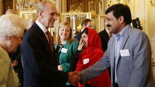 Malala went into a fit of giggles after a joke from Prince Philip