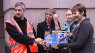 Protestors hand in petition of 23,000 signatures against privatisation of the service.