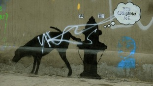 A street art graffiti by elusive British artist Banksy is seen on a wall in New York.