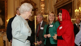 The Queen talks to Malala at the Buckingham Palace reception on Friday.