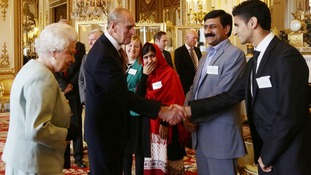 The Duke of Edinburgh makes Malala giggle with a joke.