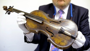 The violin reputedly played by the Titanic's bandmaster as the ship sank has been sold at auction.