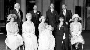 The Duchess of York, (later the Queen mother)  holds Princess Elizabeth surrounded by family and dignitaries on May 1, 1926.