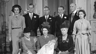 Princess Elizabeth with her son Prince Charles in Buckingham Palace and family and friends on December 15, 1948.